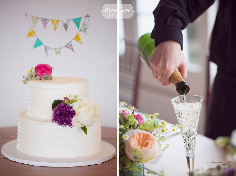 Modern and simple wedding cake with colorful pennants topper at the Wychmere.