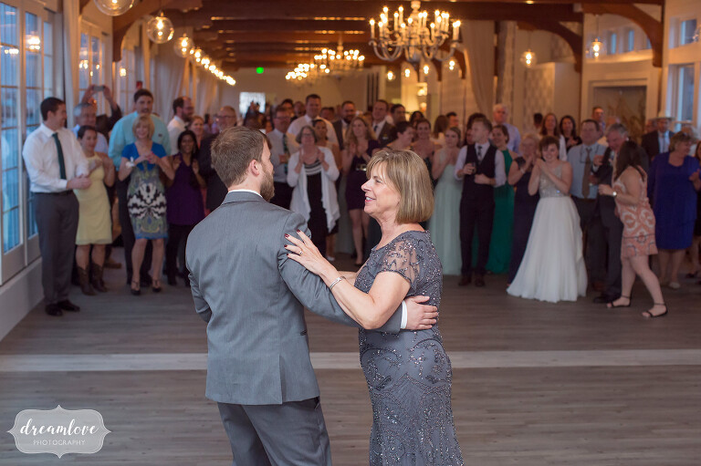 Groom and his mom dance at this modern venue on Cape Cod.