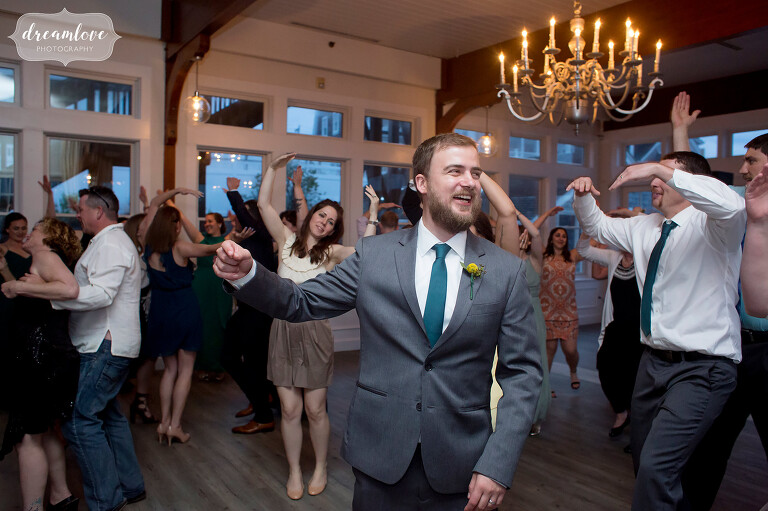 Happy photo of the groom dancing at this Wychmere wedding.