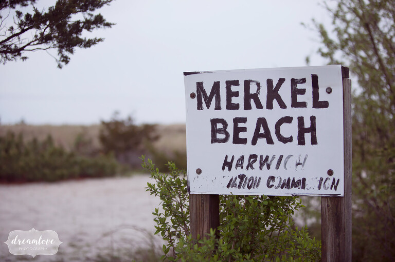 Merkel beach sign for bride and groom portraits after their Wychmere wedding.