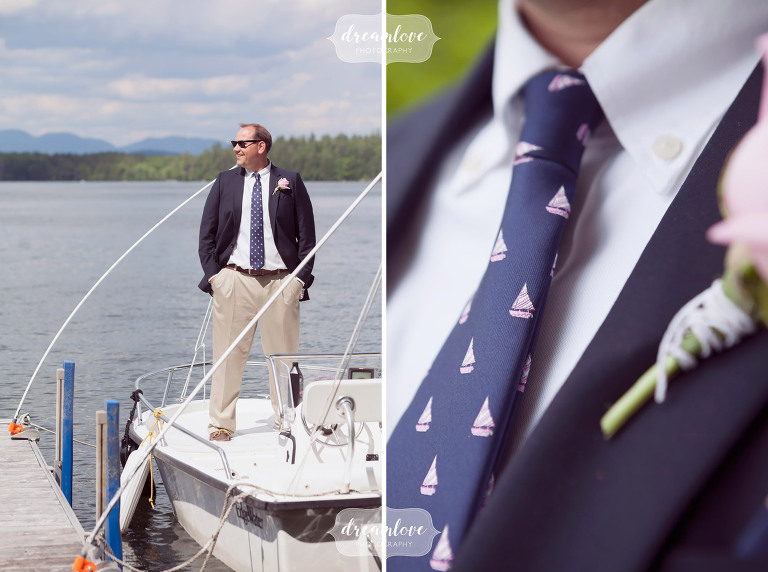 The groom wears a navy blue tie with sailboats for his lakes region wedding at this summer camp in NH.