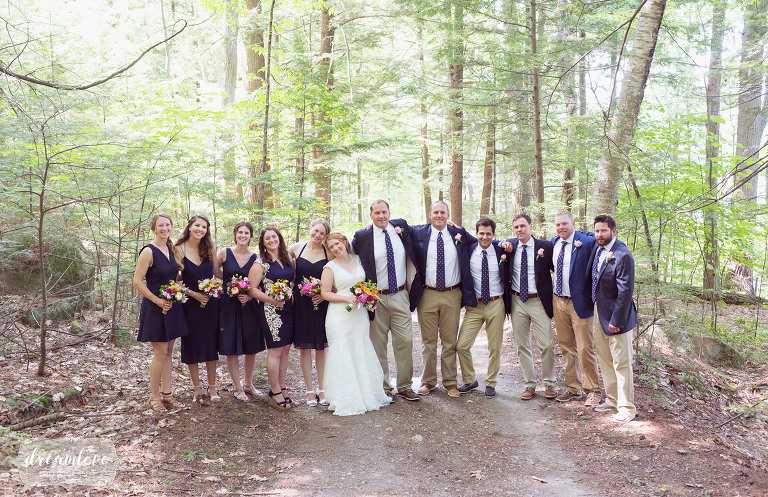 Woodsy ethereal portrait of a large wedding party in the woods at Camp Deerwood.