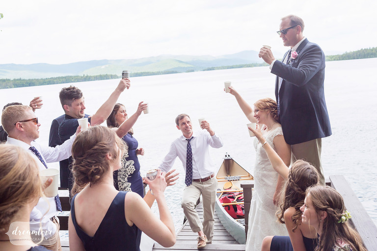 The wedding party gives a toast on the dock on Squam Lake in NH.