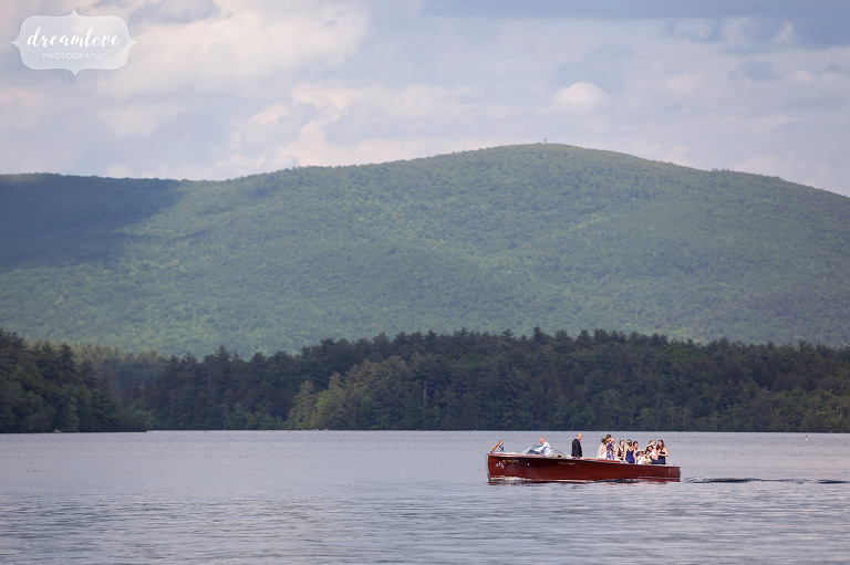 Wedding party on Squam Lake before a wedding on Camp Deerwood in NH.