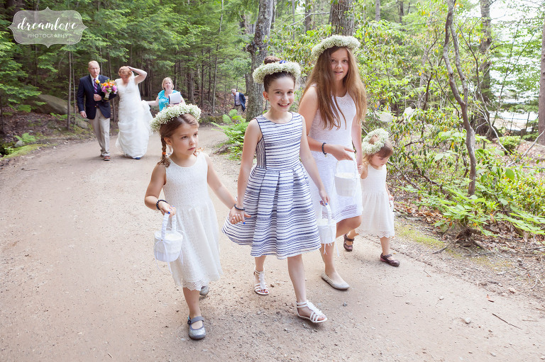Flower girls arrive at this summer camp wedding on Squam Lake in NH.