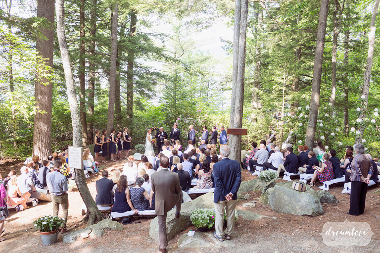 A view of the ceremony site at this summer camp wedding venue on the lake in NH.