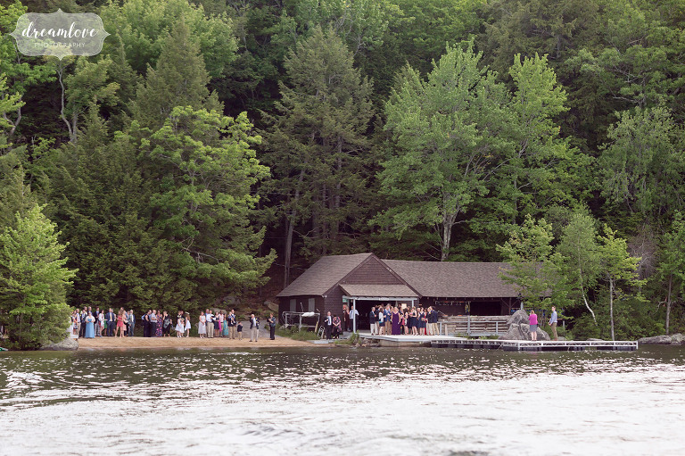 View of the barn at Camp Deerwood on Squam Lake in NH during the cocktail hour of wedding.