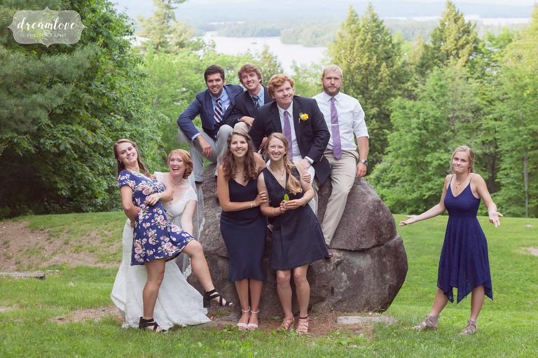 Funny wedding photo of wedding guests overlooking Squam Lake.