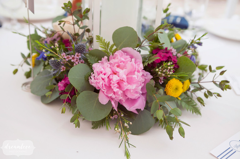 Summer camp wedding dinner table peonies and eucalyptus centerpieces.