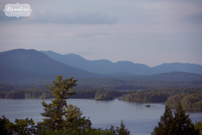 View of Squam Lake from Camp Deerwood, a rustic summer camp wedding venue in Holderness, NH.