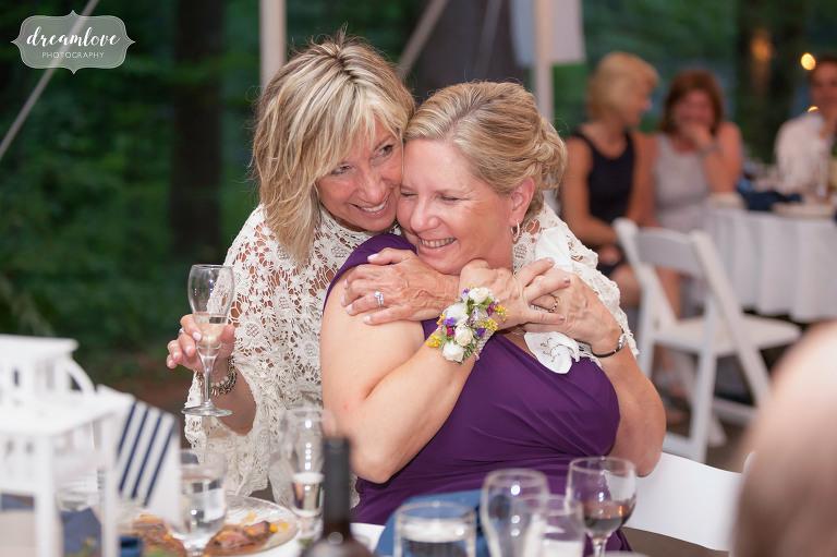 Joyful wedding photography of guests enjoying dinner in NH.