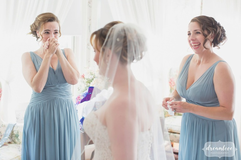 Documentary wedding photo of the bridesmaids emotional reaction when the bride puts her dress on for the first time!