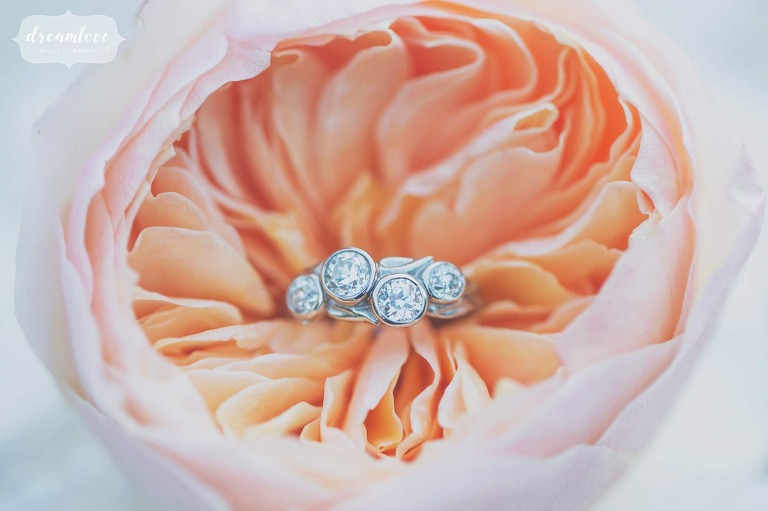 Bevel set engagement ring with four offset diamonds in silver band for this Lyman Estate wedding near Boston.