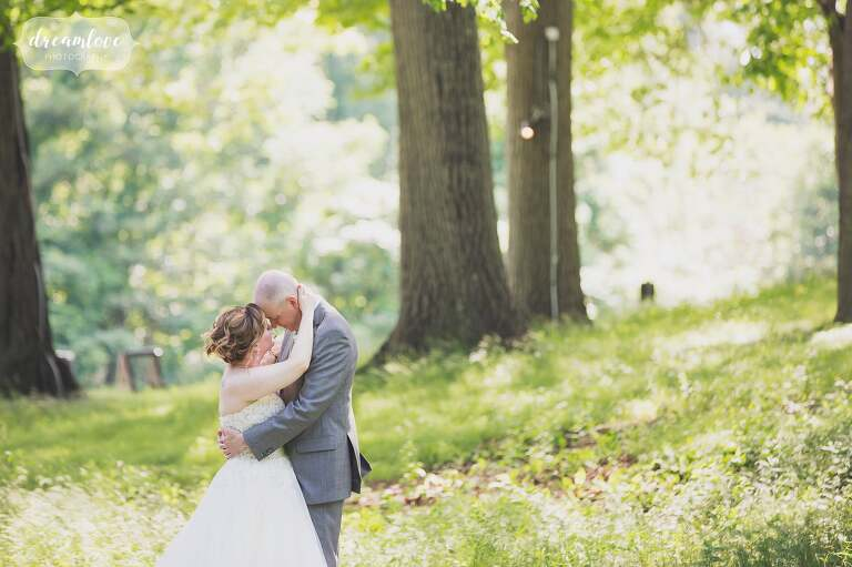 Ethereal wedding photo of the bride and groom outside under the trees near Boston, MA.