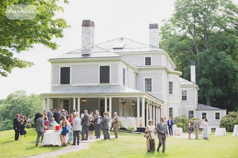 Guests enjoy the cocktail hour at the Lyman Estate historic wedding venue in MA.