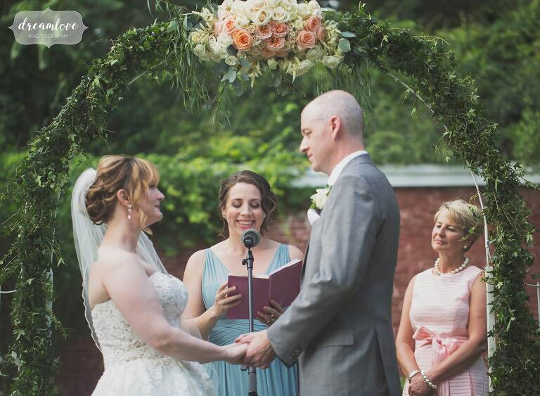 This romantic garden wedding ceremony next to the greenhouse at the Lyman Estate. was beautiful in June.