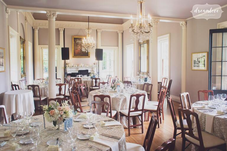 Indoor dinner tables set up at the historic Lyman Estate venue in MA.