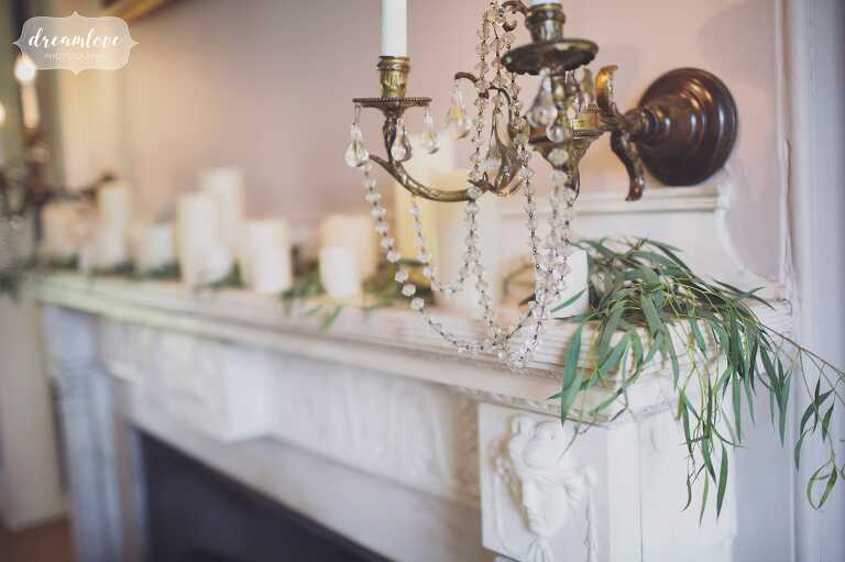 Candles and greenery on the mantel at the historic Lyman Estate wedding venue in MA.