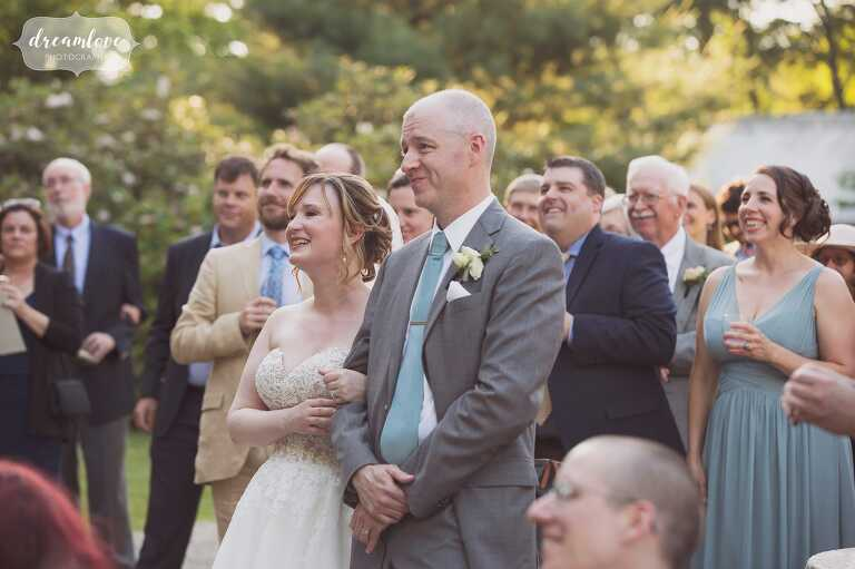 The bride and groom speak to the guests at the Lyman Estate in Waltham.