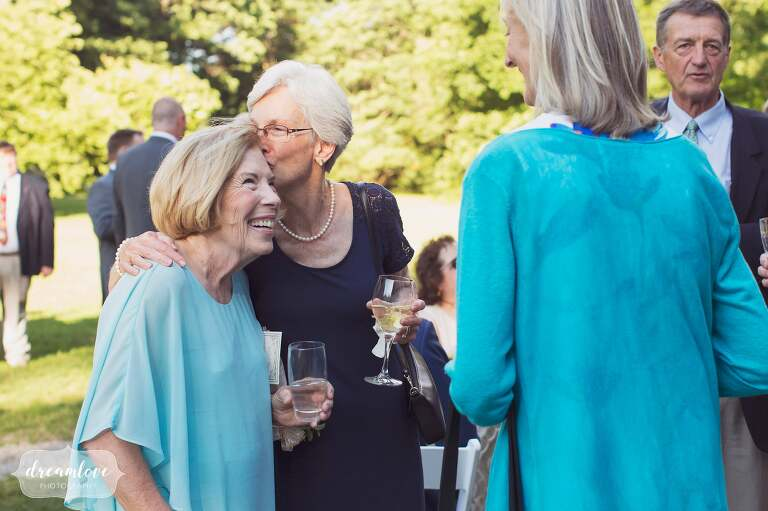 A happy photo of the mother of the bride at the cocktail hour at the Lyman Estate in MA.