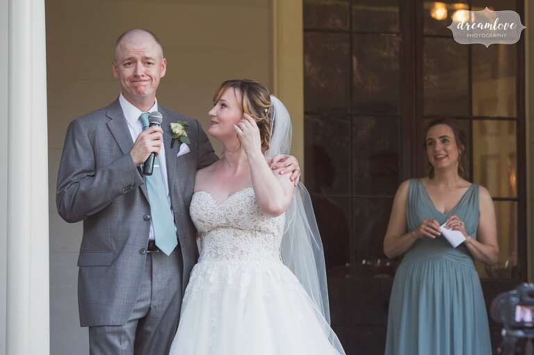 Bride and groom toast the crowd at the Lyman Estate in MA.