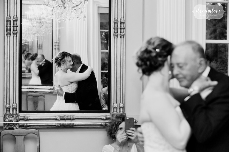 Best documentary wedding photo of the bride dancing with her father at the Lyman Estate near Boston.