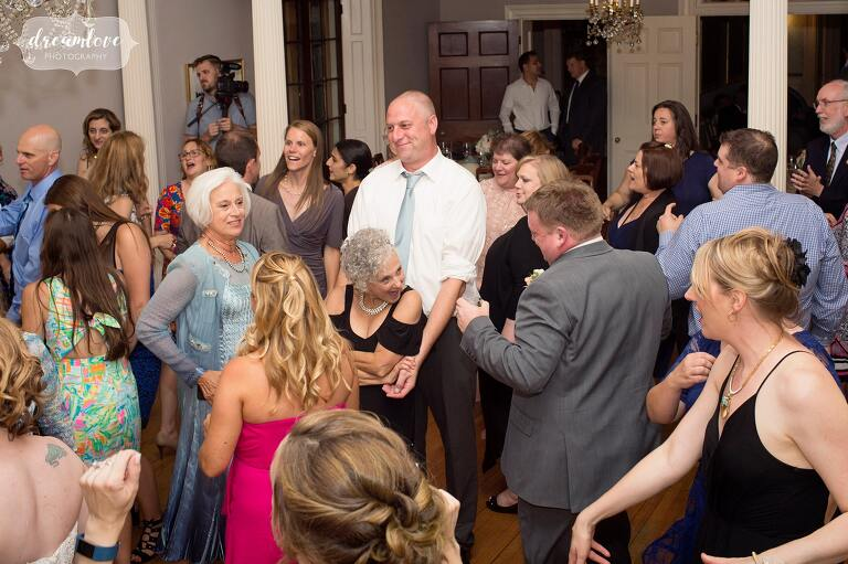 Funny photo of wedding guests dancing at the Lyman Estate.