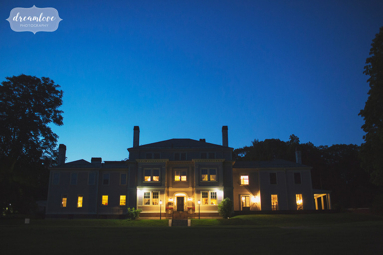 This Lyman Estate wedding venue in MA is bathed in twilight blue light at dusk.