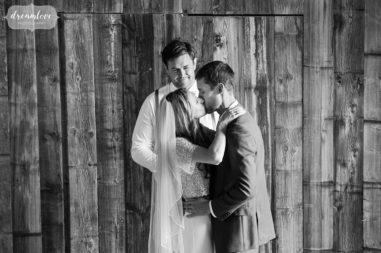 Black and white wedding photo of the kiss at the Comfort Farm in Stowe.
