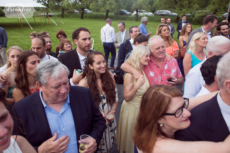 Candid photos of wedding guests watching the first dance at this barn wedding in Stowe.