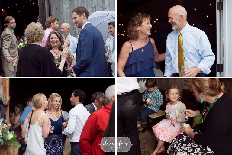 Natural wedding photos of the guests laughing during the outdoor cocktail hour at this barn wedding in Stowe.