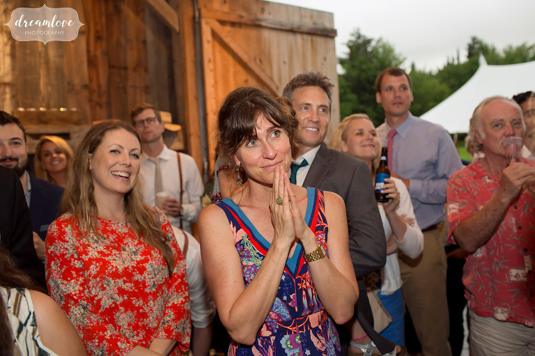 Natural photos of the wedding guests watching first dances in Stowe, VT.