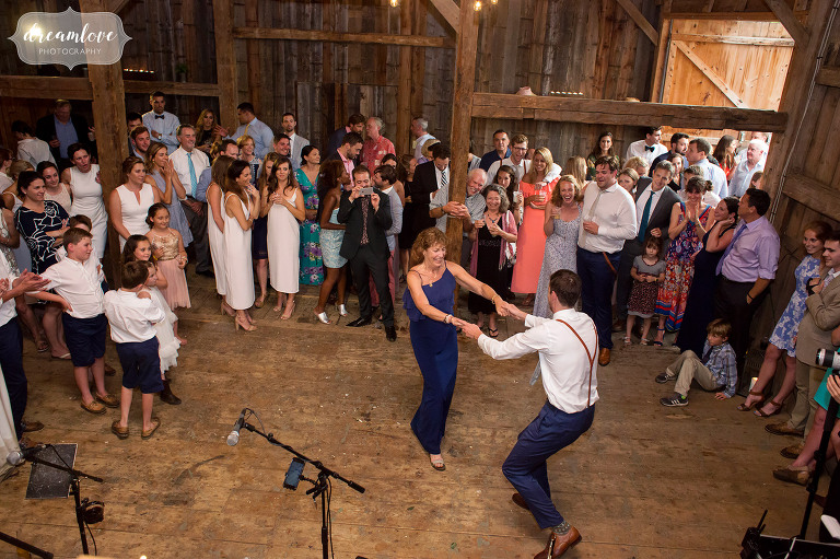 The mother of the groom and her son dance at this barn wedding in Stowe.