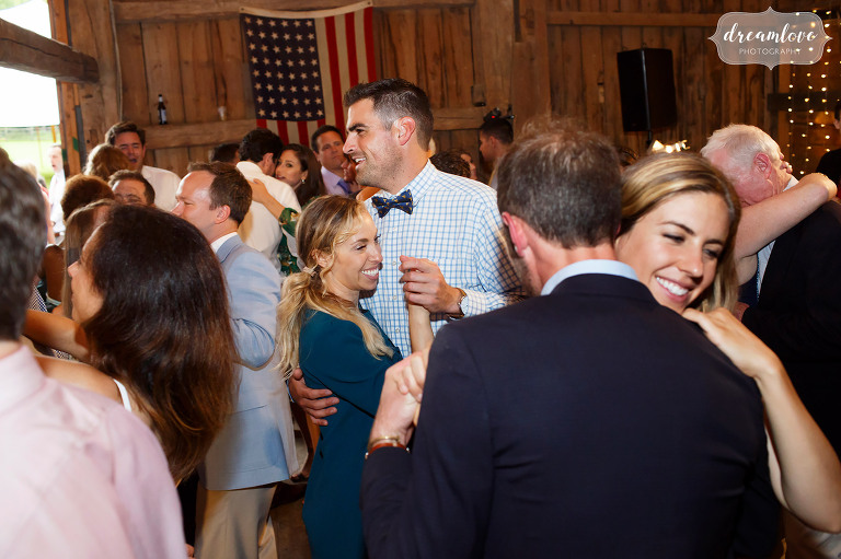 Layered photo of guests dancing at the Stowe Comfort Farm barn in VT.