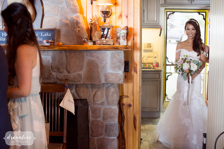Bride waiting in the house before walking down the aisle at her backyard wedding in Wolfeboro, NH.