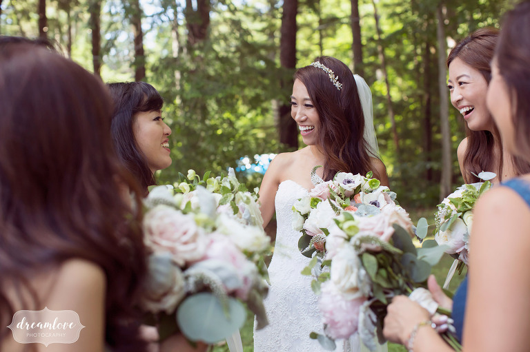 Happy wedding photo of the bride surrounded by her bridesmaids after this Korean wedding in Wolfeboro.