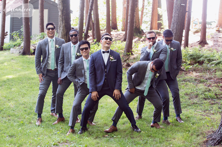 Funny photo of Korean groomsmen wearing sunglasses and acting silly outside under the trees in Wolfeboro, NH.