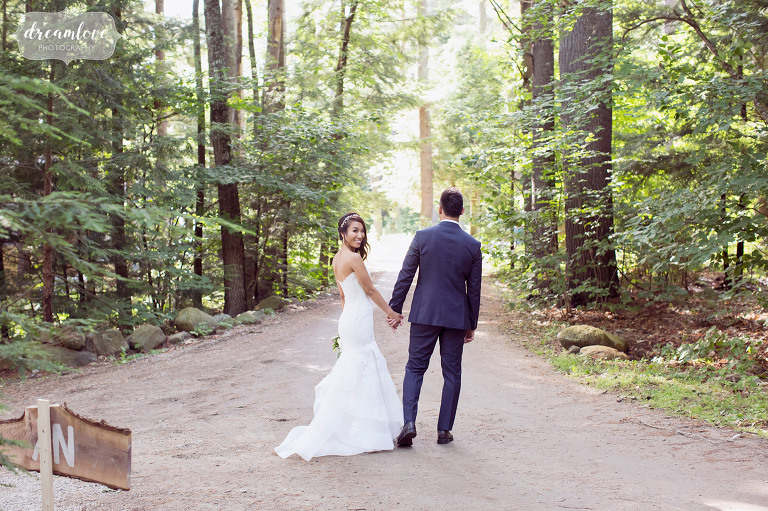 Natural and woodsy wedding portraits of the bride and groom in the forest in Wolfeboro.