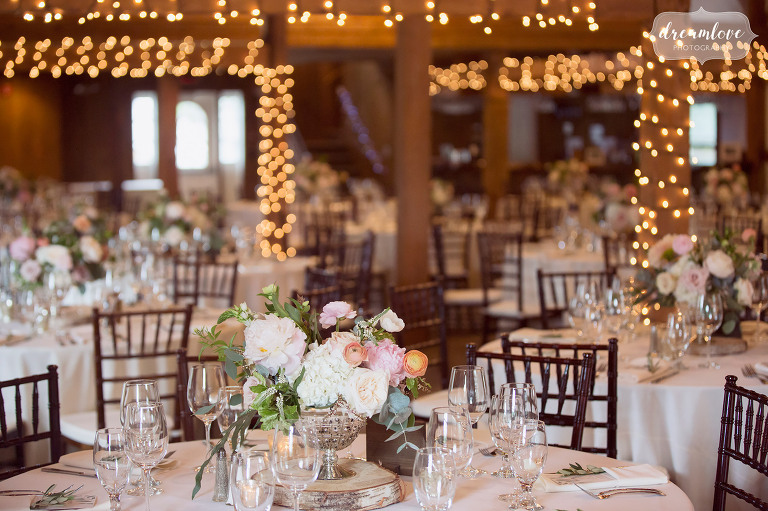 This rustic wedding reception in Wolfeboro, NH was at the Inn on Main with pastel colors.