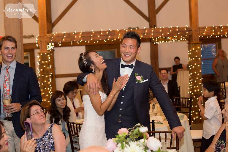 The bride laughs at this Wolfeboro NH wedding reception at the Inn on Main.