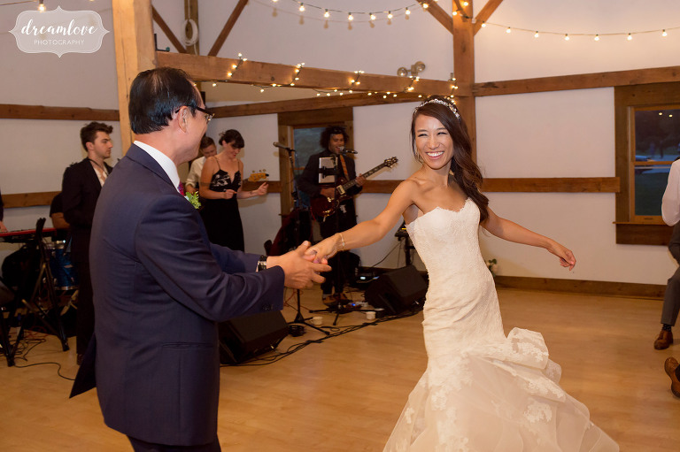 The father of the bride swings his daughter around the dance floor during their dance at the Inn on Main in Wolfeboro, NH.