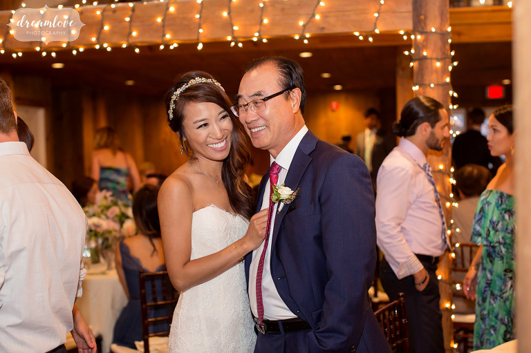 Great documentary photo of this bride laughing with her dad after their dance at the Inn on Main wedding reception venue in Wolfeboro, NH.