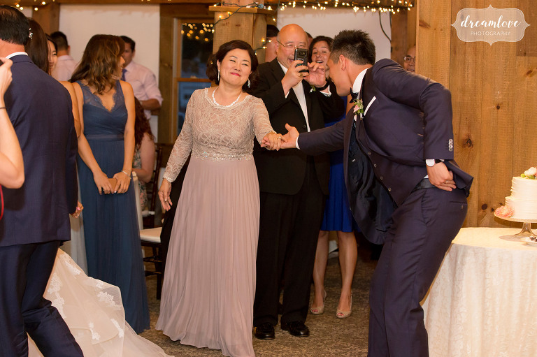 Sweet moment photo of the groom asking his mom to dance at this Wolfeboro, NH wedding reception.