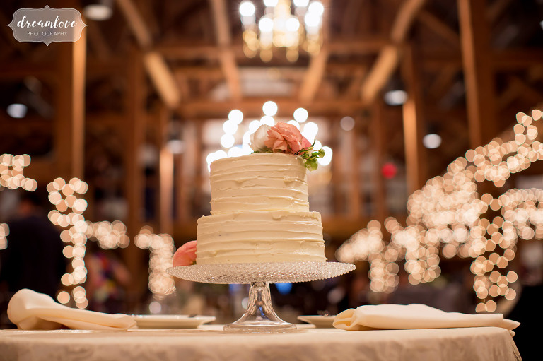 Simple, two-tiered wedding cake at this rustic reception at the Inn on Main in Wolfeboro.