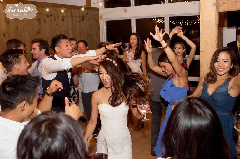 The bride is surrounded by friends on the dance floor at the Inn on Main in Wolfeboro.