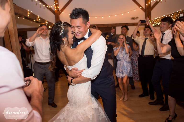 Bride and groom embrace on the dance floor at the end of their Wolfeboro NH wedding.