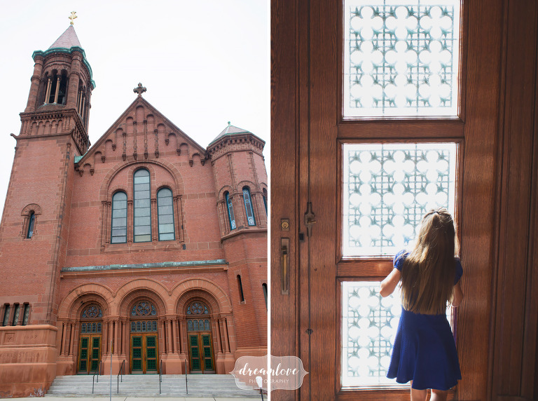 Little girl looking out window of the St. Mary Star of the Sea church in downtown Beverly, MA before a wedding.