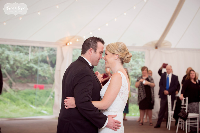 Romantic photos of the bride and groom's first dance under the sailcloth tent at the Moraine Farm.