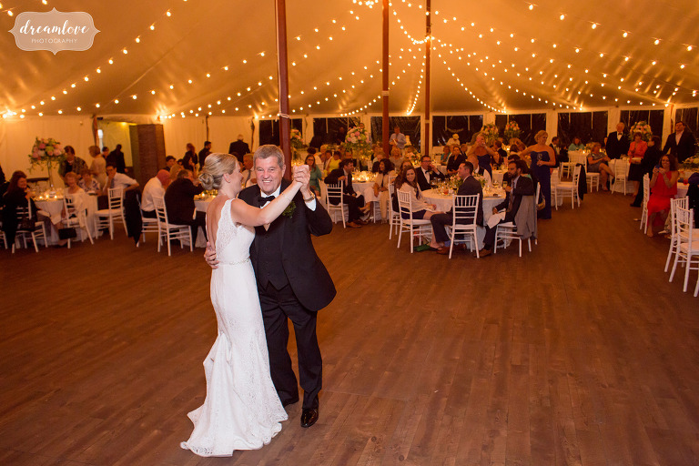 The bride dances with her dad in the sailcloth tent at the Moraine Farm.