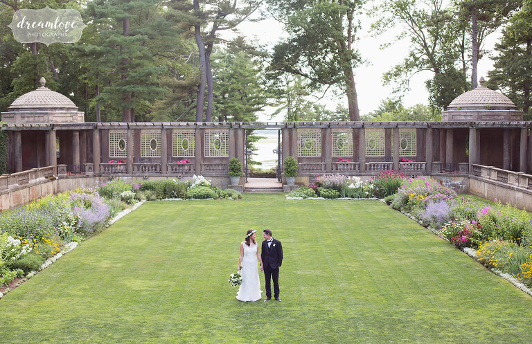 Bride and groom stand in the middle of the Italian Garden at this north shore estate wedding in Ipswich, MA at the Crane Estate.